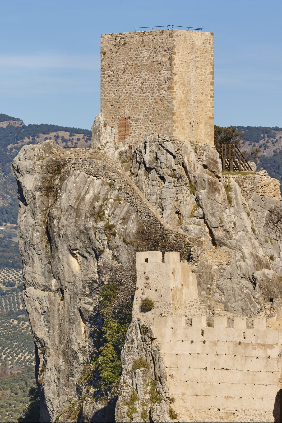 Ancient castle tower and olive fields in La Iruela. Spain
