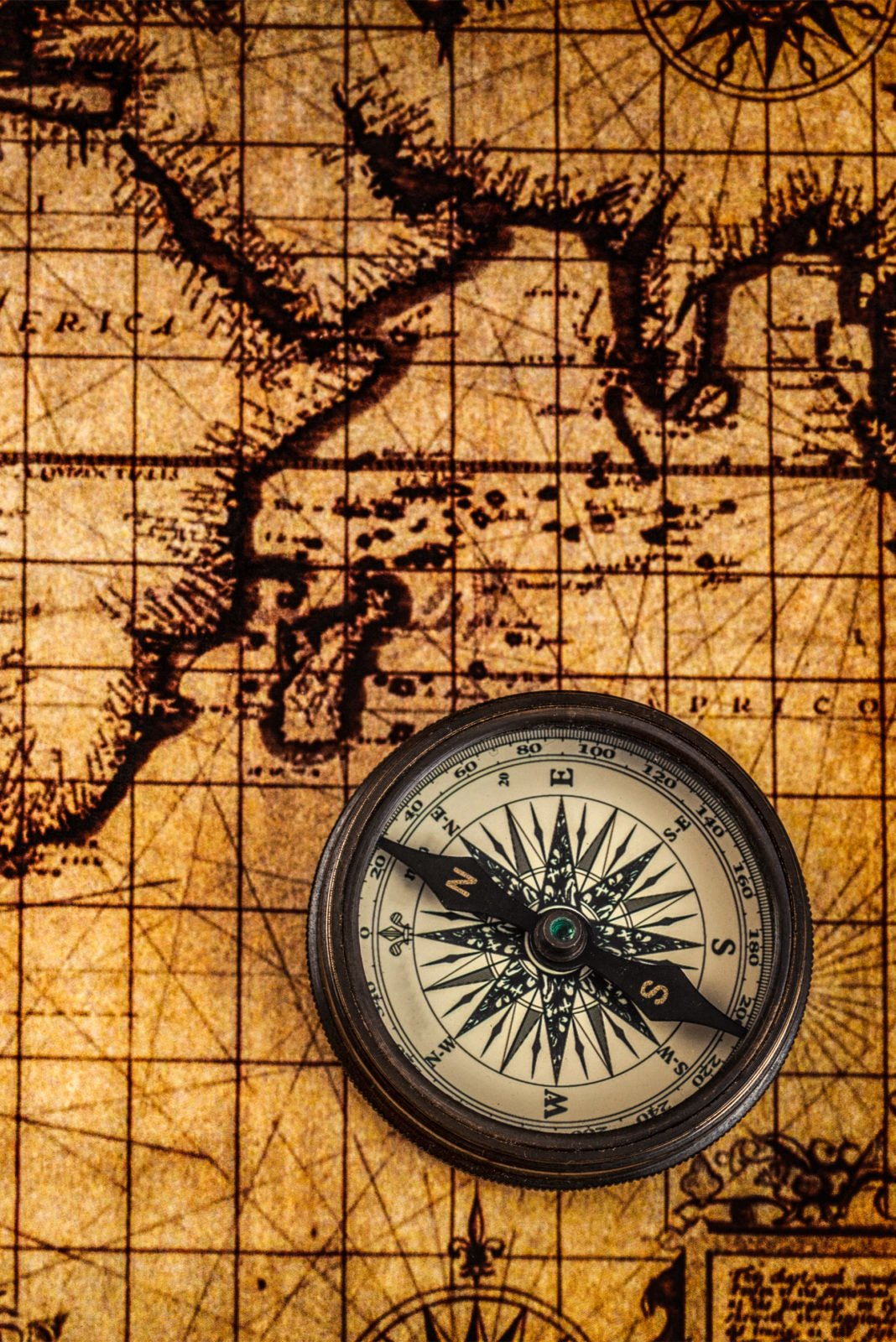 Map of the world with a compass